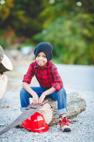 kid in a lumber jack costume